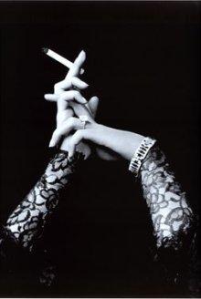 womans-hands-holding-cigarette.jpeg